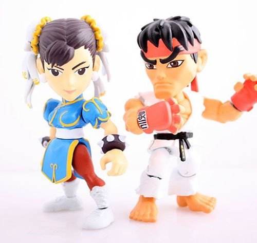 Chun-Li and Ryu from the Street Fighter The Loyal Subjects Blind Mystery Box Mini Figures standing at the ready!